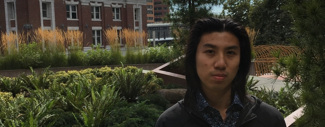 Geography student Kevin Ho with King Street Center building near Pioneer Square