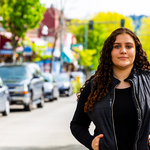 Courtney Hooks in city street.