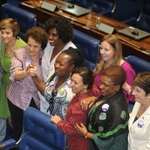 Caitlin with domestic workers and legislators on the day the amendment extending labor rights to domestic workers was passed in April 2013.