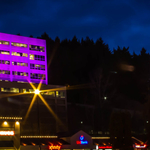 T-Mobile Headquarters in Bellevue, WA, covered in purple light.