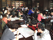 Students studying maps