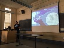 Geography Graduate Student Edgar Sandoval presenting a PowerPoint presentation.