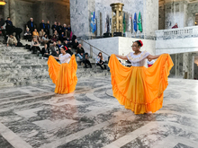 Two dancers performing in a government building.
