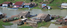 Houses built on a riverbank in Cambodia.