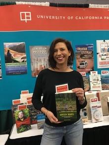 Professor Megan Ybarra Holding Her Book, Green Wars.