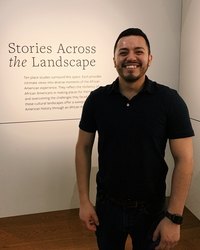 Sandoval in front of a museum exhibit