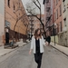 Geography Major Ji Hae Walks on a New York City Street